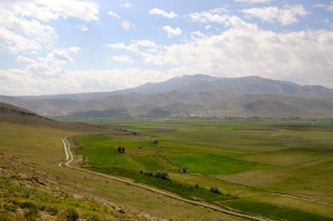 Irrigation, farmland, village, and distant mountains