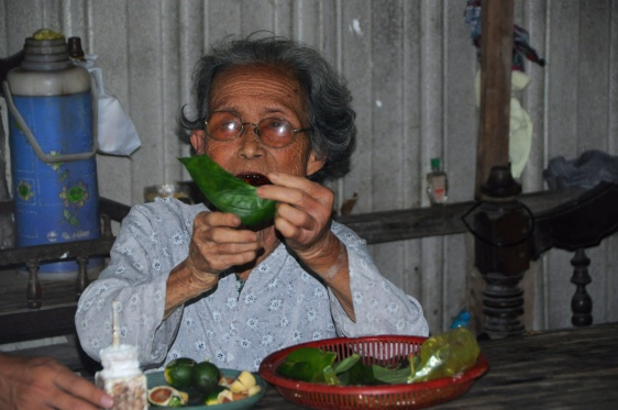 She Demonstrates the Proper Wrapping of the Betel Nut